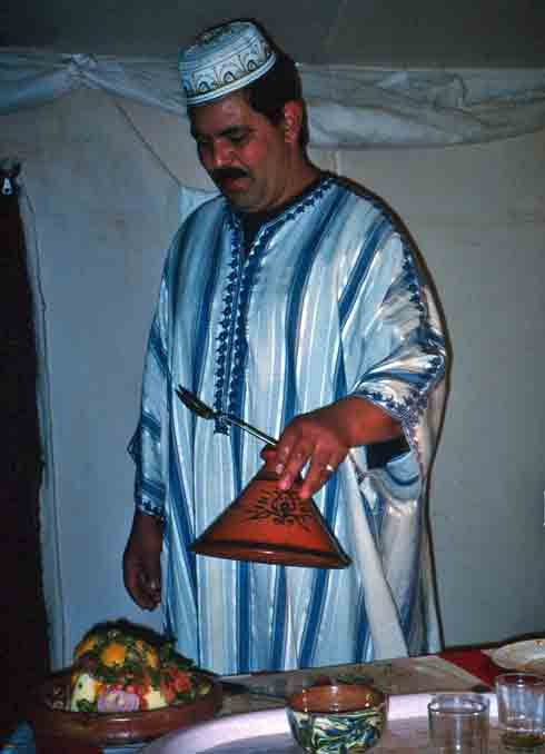 Berber chef serves traditional tagine.