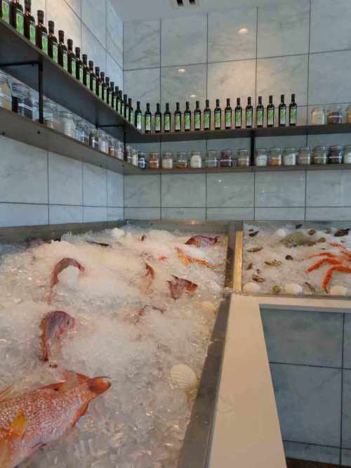 Fresh fish, different kinds of salt, and good olive oil great customers at the entrance.
